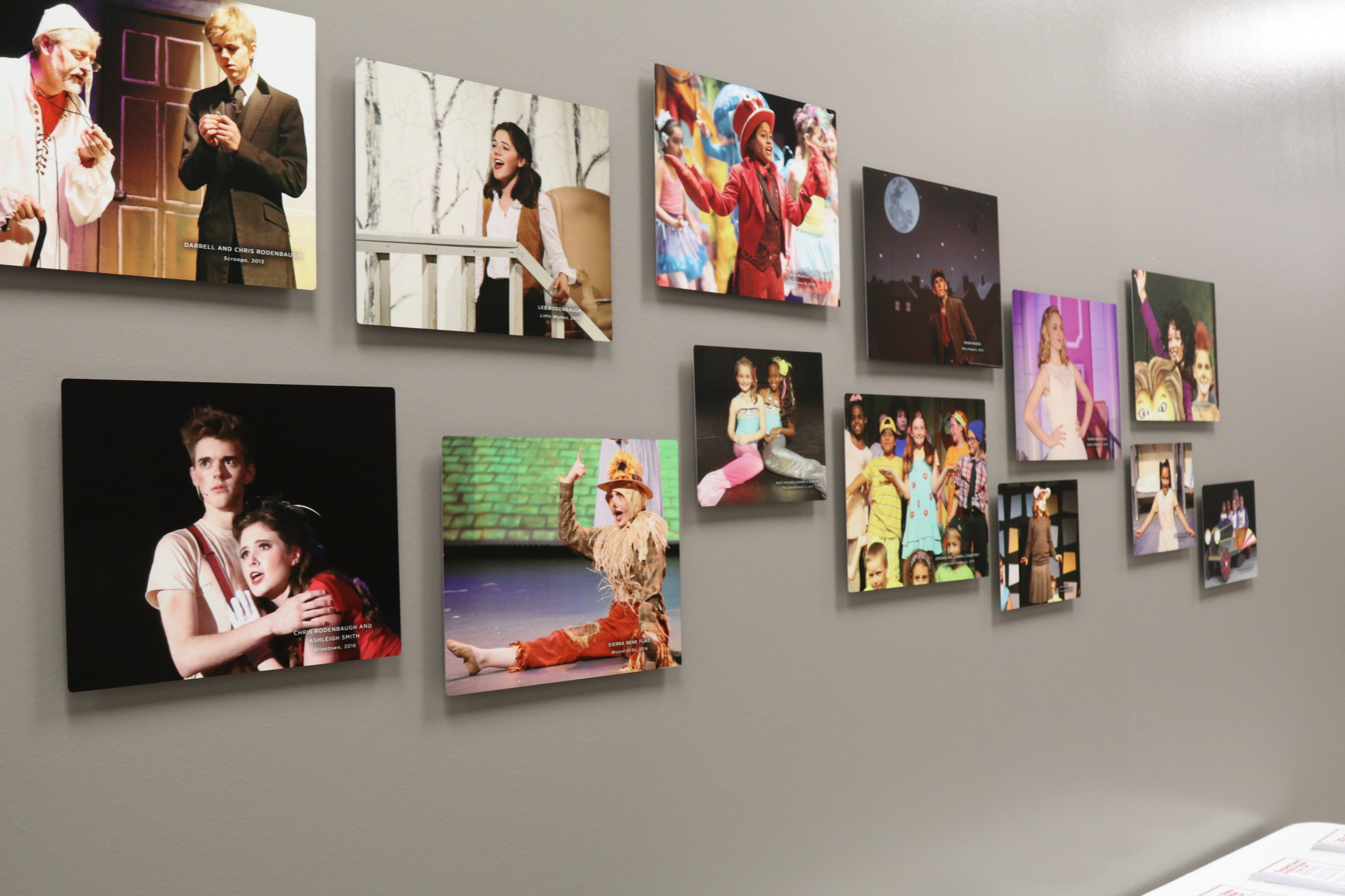 NTPA photo gallery wall featuring photos of students from past productions