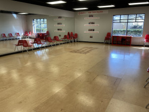 Rehearsal room with wooden floors and mirrors